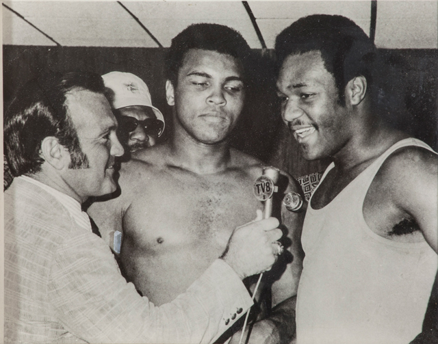 Black and White photo of Jerry Gross interviewing Muhammad Ali and George Foreman